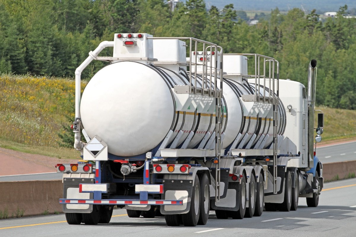 iStock-950131304 - Semi Tanker Truck Travelling Highway With Chemical Cargo-1