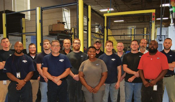 Group picture of Dixon's apprentices, steering committee members and on-the-job trainers