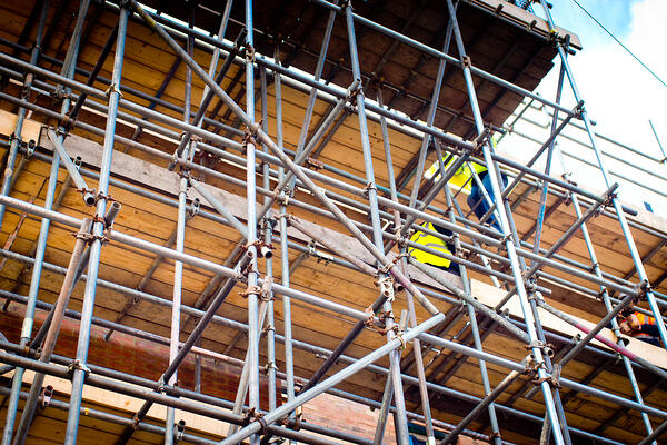 new building construction with scaffolding_iStock-951855926