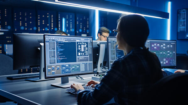 Smart-female-it-programmer-working-data-center-control-room