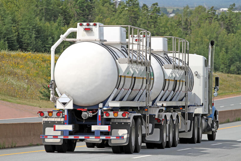 semi-tanker-truck-traveling-highway-with-chemical-cargo