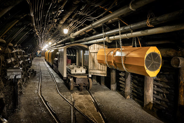 Hard-coal-mine-underground-corridor-with-steel-support-system-electrical-equipment