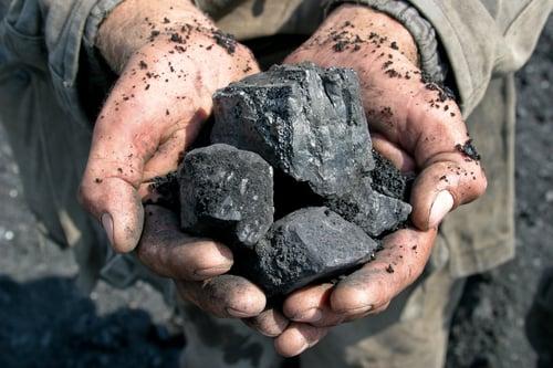 Miner-holding-coal-in-hands